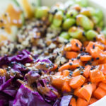 Quinoa Bowl with Fresh Vegetables and Spicy Peanut Dressing