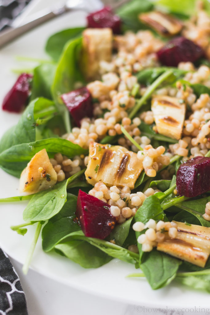 Arugula salad with roasted parsnips, couscous, and beets