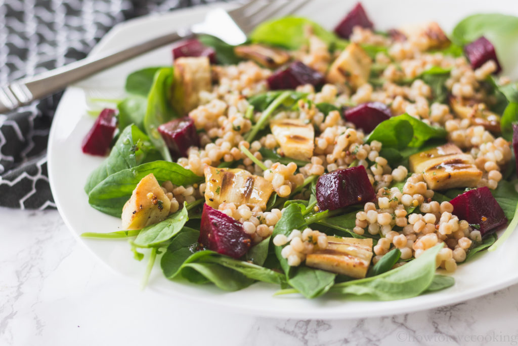 Arugula salad with toasted couscous and roasted vegetables