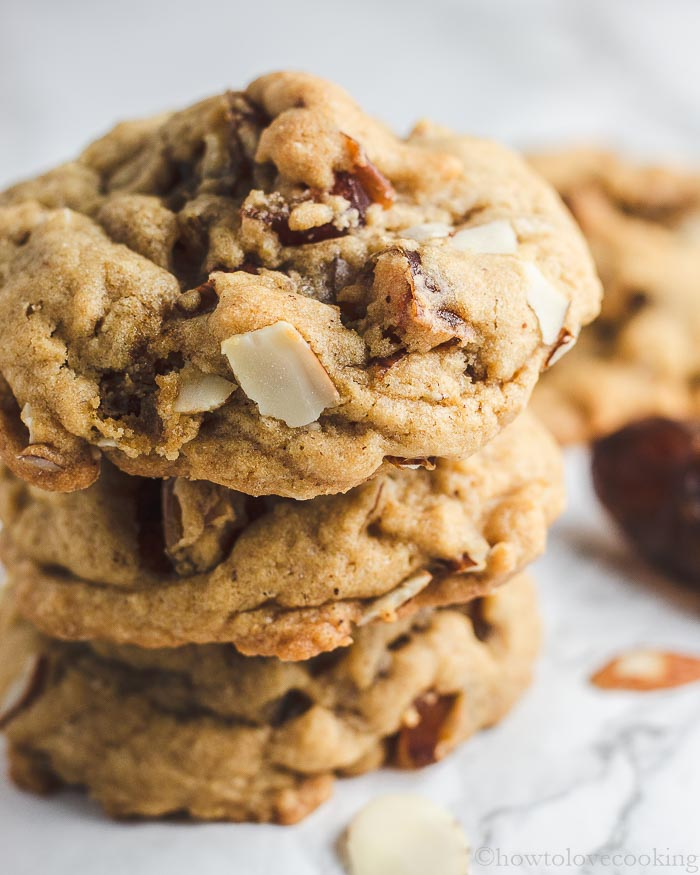 Stack of golden cookies with dates and almonds